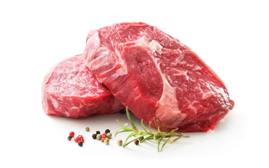 fresh raw rib eye steaks isolated on white background