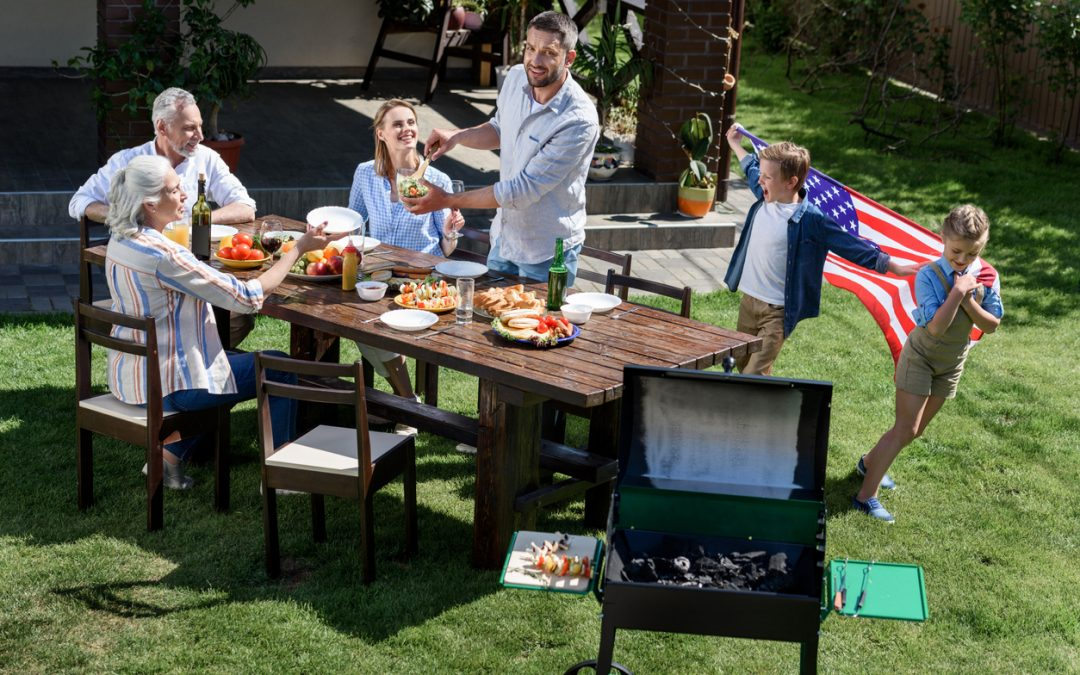 family having barbecue while celebrating with yummy 4th of July recipes together, Independence Day concept